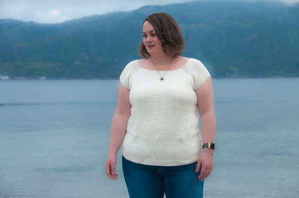 Natare Top Crochet Pattern Design , intermediate crochet top modeled by the sea