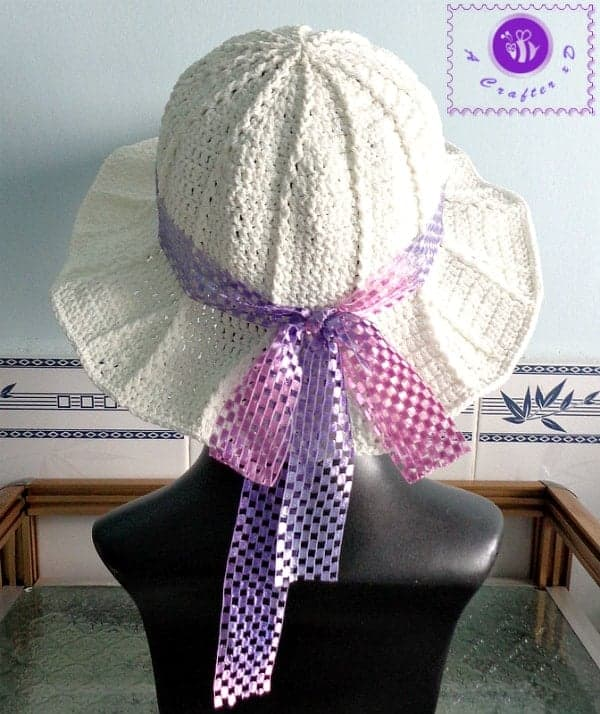crochet sun hats for summer, a white crocheted sun hat with a ribbon