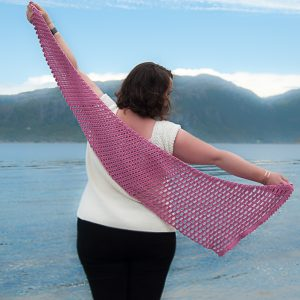 soft easy crochet shawl, feels like butta yarn, lion brand yarn, shawl modeled by the beach