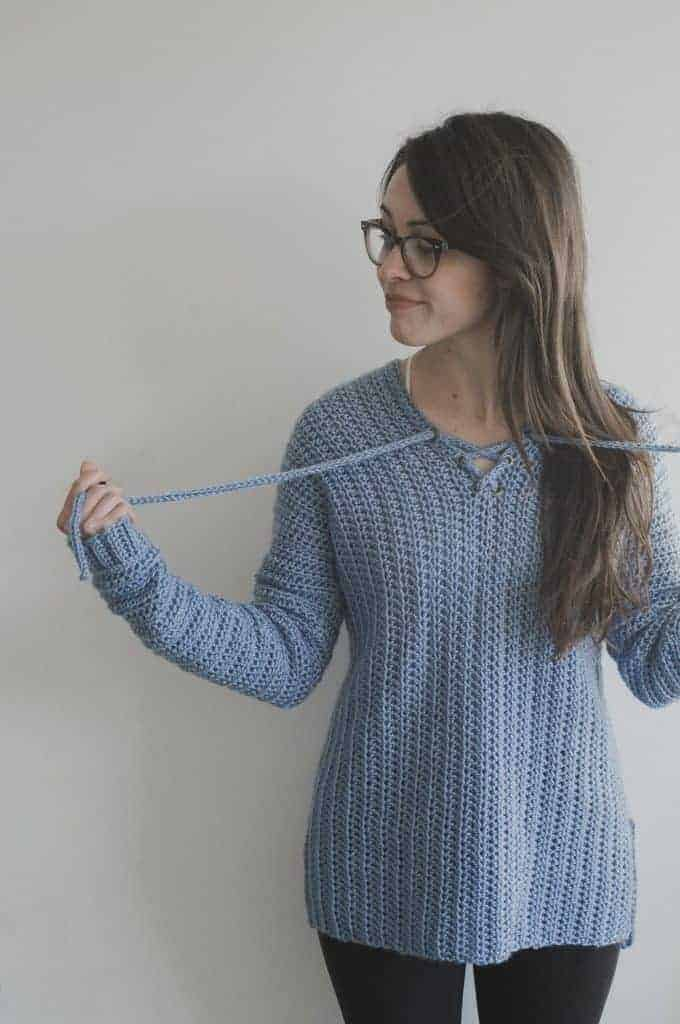great crochet sweaters, a blue crochet sweater modeled with fun details